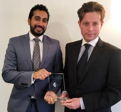 Mark Williams Chief Audiologist (r) and Rekesh Patel Harley St, London Region Manager and Senior Audiologist (l) with the award