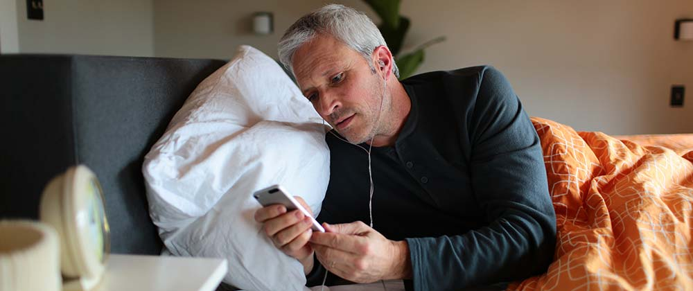 tinnitus sufferer about to start sound stimulation whilst sleeping